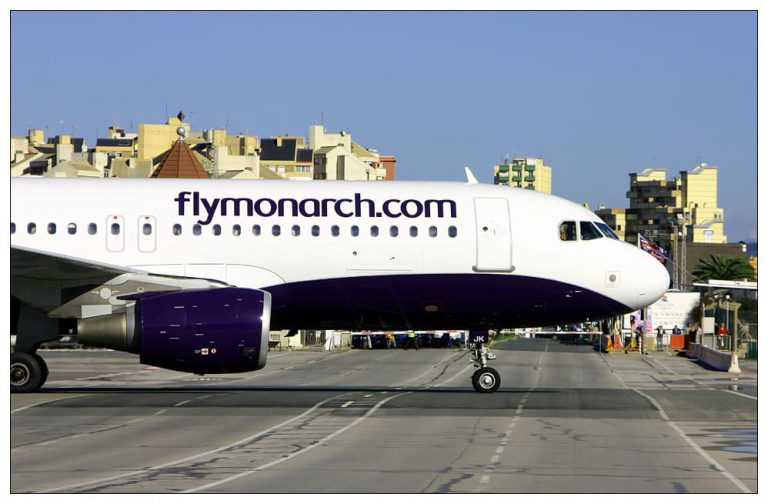 Gibraltar Airport - Monarch aircraft crosses the road