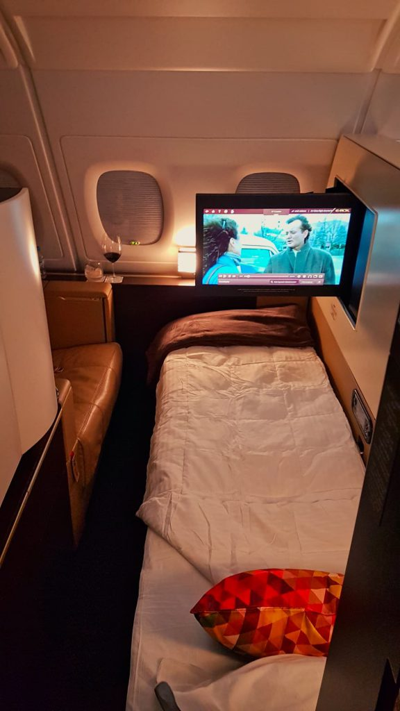 Etihad Apartment First Class Bed and TV
