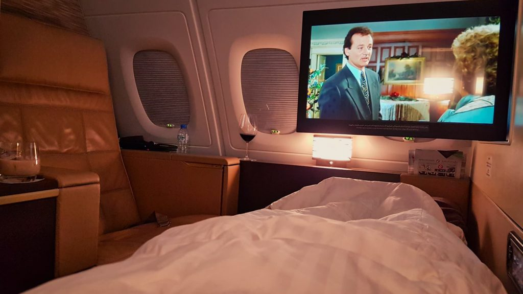 Etihad Apartment First Class TV in bed