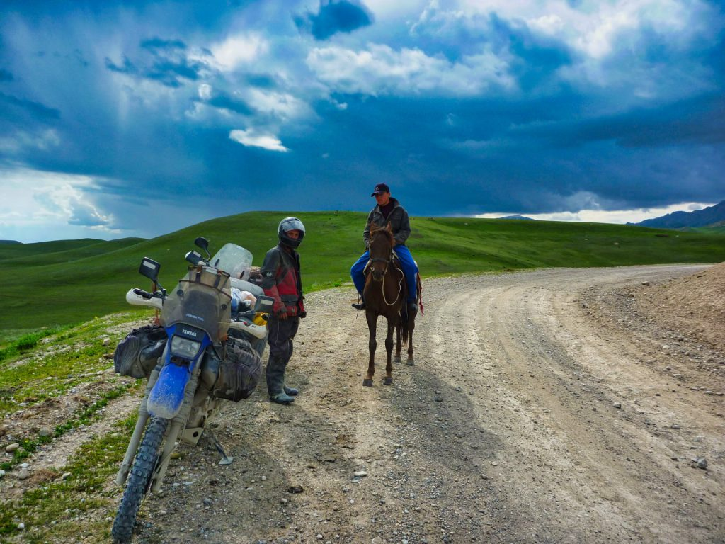 Kyrgyzstan biking Mountain horse rider